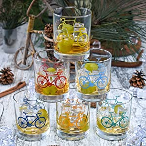 stack whiskey glasses bicycle